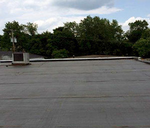 Photo of a roof replacement performed by Allied Commerical Roofing Services.